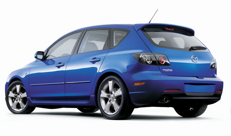 A blue 2006 Mazda 3 hatchback.