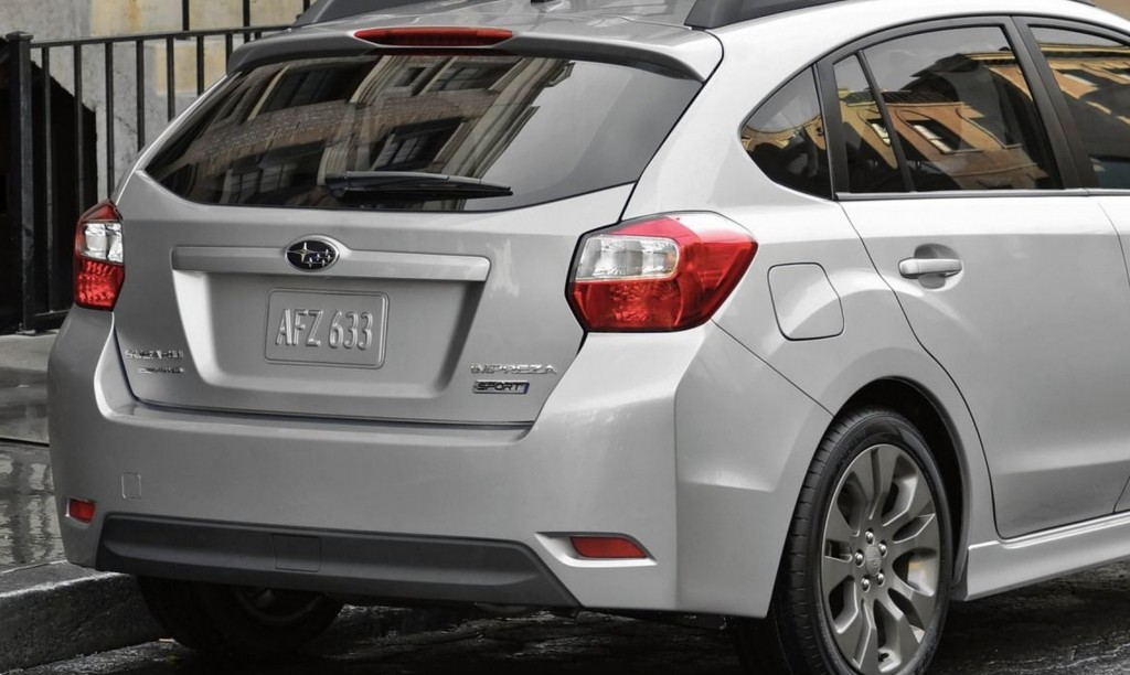 The rear end of a silver 2013 Subaru Impreza hatchback
