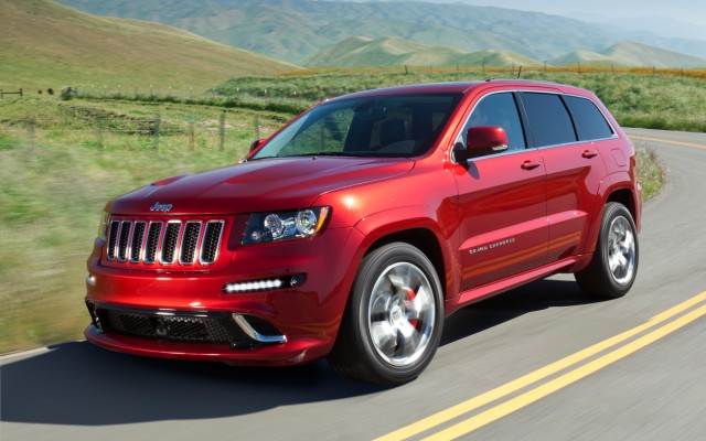 Red Red Jeep Grand Cherokee SRT-8 on road side view
