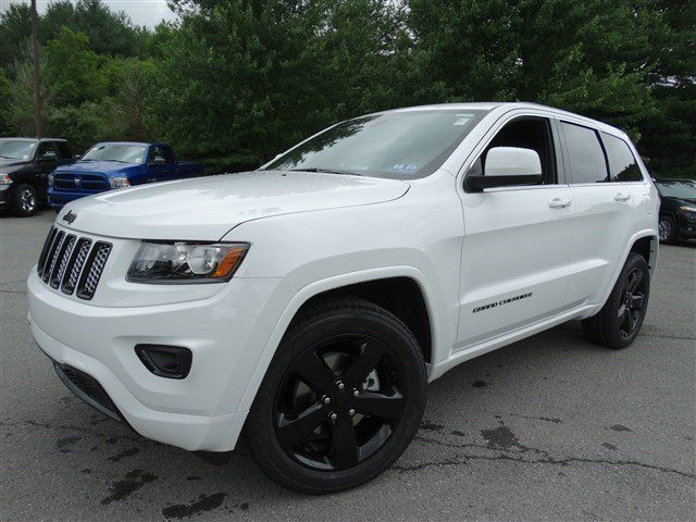 White 2014 Jeep Grand Cherokee Altitude Edition with black wheels