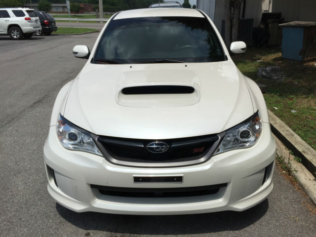 Front view of a White 2013 Subaru WRX STI sedan