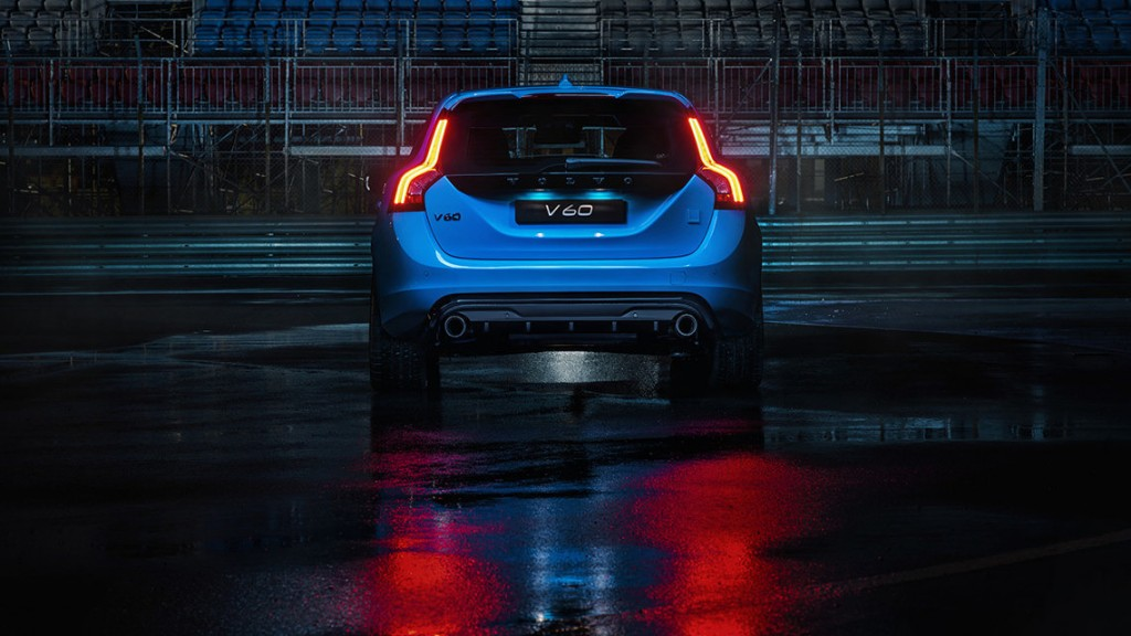 The rear end of a blue Volvo V60 Polestar